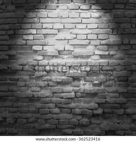 old brick wall background in basement with beam of light - stock photo