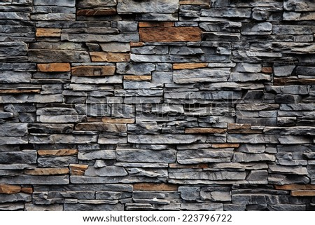 Old brick wall from a flat stone - stock photo