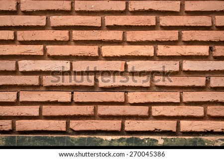 Old brick wall in background texture - stock photo
