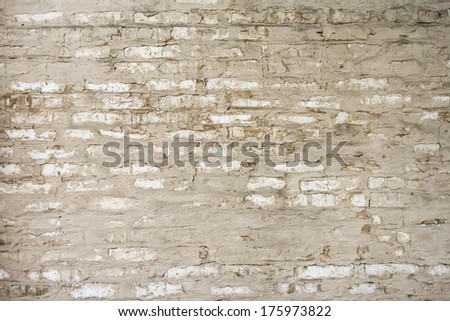 Old brick wall made with sand color stones. - stock photo