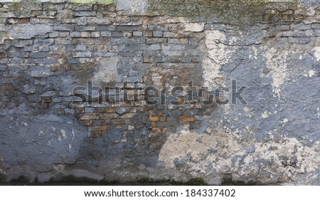 old brick wall painted blue desaturated - stock photo