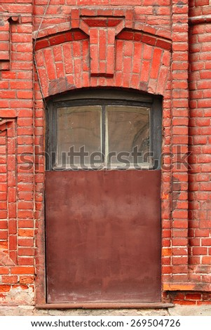 Old brick wall with boarded up window - stock photo