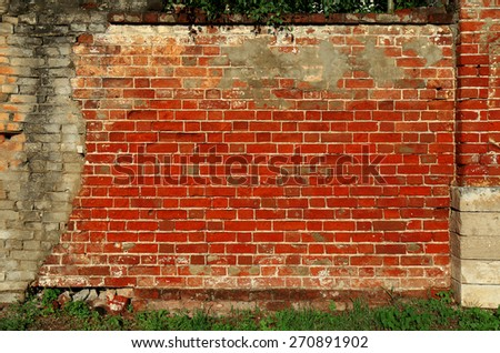 Old brick wall with red bricks - stock photo