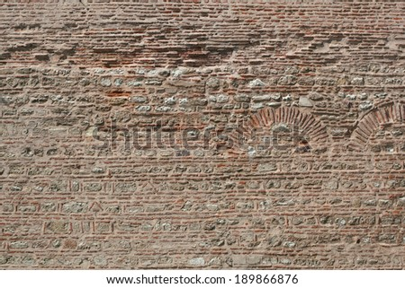 Old brick wall with the pattern for the archs - stock photo