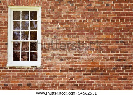 Old Brick Wall with White Window - stock photo