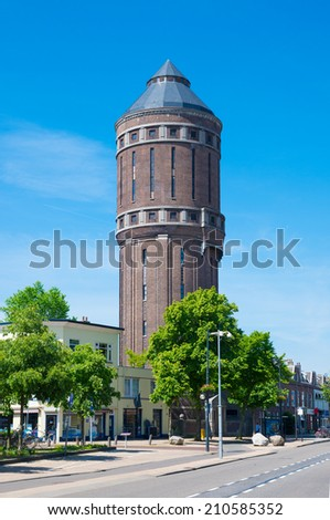 old brick water tower in utrecht, netherlands. Built around 1917, it has a 1000 cubic meters reservoir and a height of 43,5 meter - stock photo