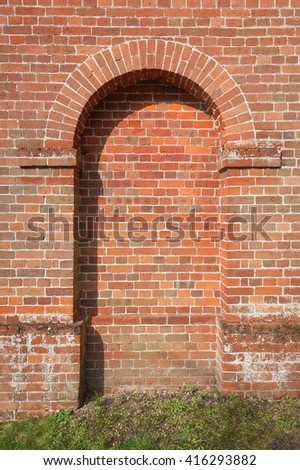 old brickwork framed doorway with space for copy text - stock photo