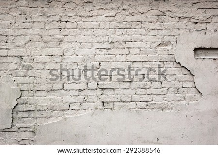 Old Broken Damaged Weathered Plastered Painted White Brick Wall  With Chuckhole Abstract Isolated Background Texture - stock photo