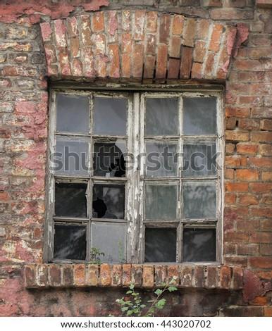 Old broken factory window - stock photo
