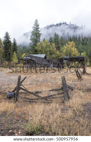 Old broken fence in grass in Okanogan county in Washington near Winthrop.