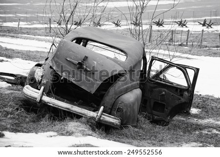 Old broken german car. black and white - stock photo