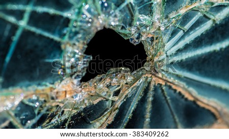 Old broken glass car window as background image - stock photo