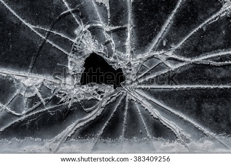 Old broken glass car window as background image, black and white image - stock photo
