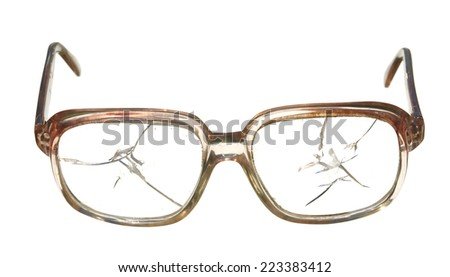 Old broken glasses isolated on white background.         - stock photo
