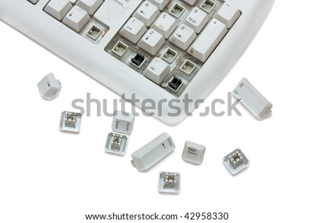 Old broken keyboard with scattered keys. Isolated on white background. - stock photo
