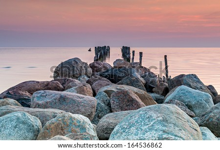 Old broken pier at the Baltic Sea, Latvia, Europe - stock photo