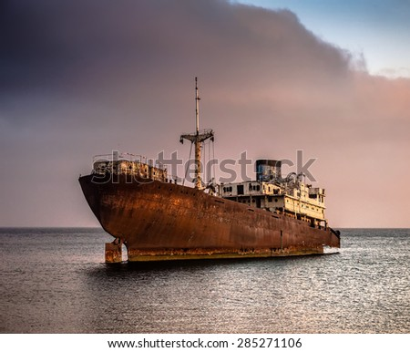 old broken ship agrounded near Lanzarote seashore, Canary Islands, Spain - stock photo