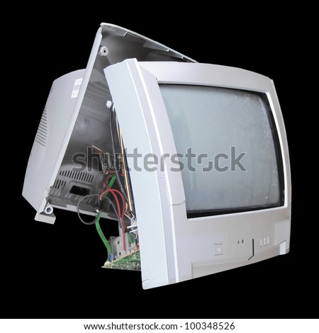 Old broken TV set isolated over black background