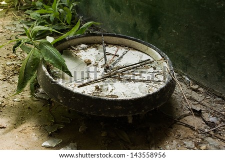 Old broken wall clock in an abandoned house - stock photo