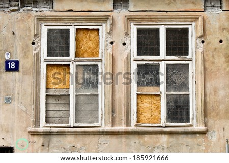 Old broken windows in abandoned house