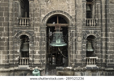 Old bronze bell in the Cathedral of Mexico City These ancient bronze bells are still rung every day since the conquest of Mexico by the Spanish conquerors. - stock photo