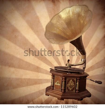 Old bronze gramophone on vintage background - stock photo