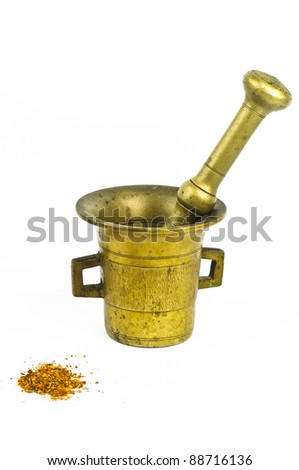 Old Bronze Mortar with spice Isolated on white background - stock photo