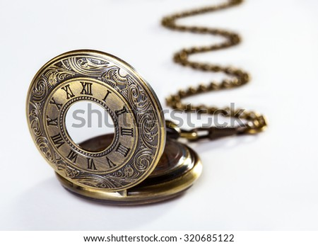 Old bronze pocket watch over white background - stock photo
