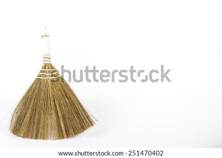 old broom isolated on white - stock photo