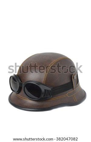 old brown leather helmet witht goggles on white background - stock photo