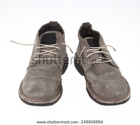 Old brown leather shoes - stock photo
