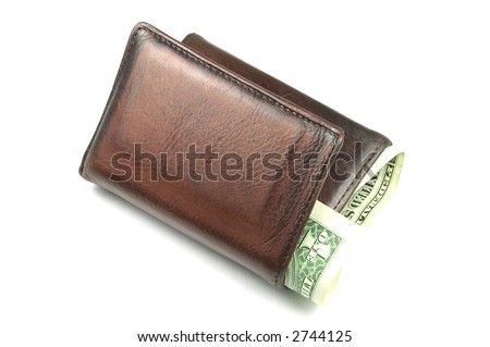 Old brown leather wallet with a dollar bill sticking out, isolated on white. - stock photo