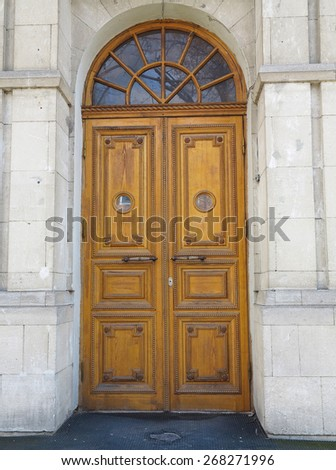 Old brown vintage wooden door with decoration pattern