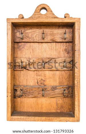 Old brown vintage wooden rusty key holder box, taken outdoor - stock photo