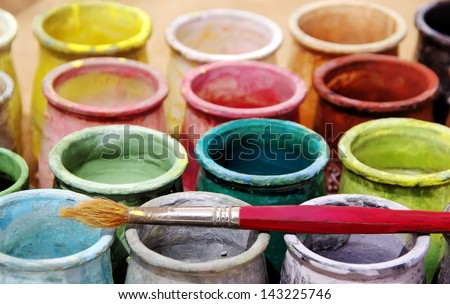 Old brush and colorful bottles - stock photo