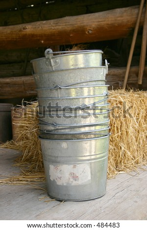 Old bucket on a wood floor - stock photo
