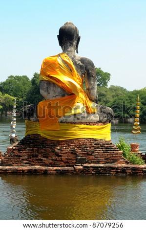 old buddha in Thai temple flood in Ayuttaya, Thailand - stock photo