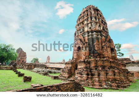 Old buddha pagoda temple with cloudy white sky in Thailand - stock photo
