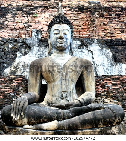 Old Buddha Statue at Wat Mahathat Temple in Sukhothai Historical park  - stock photo