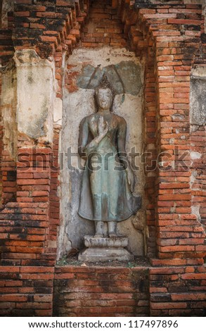 Old Buddha statue in Wat Wat Phra Si Rattana Mahathat Temple Ayutthaya , Thailand. - stock photo