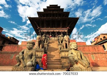 Old buddhistic statues on Bhaktapur Square. Kathmandu, Nepal - stock photo