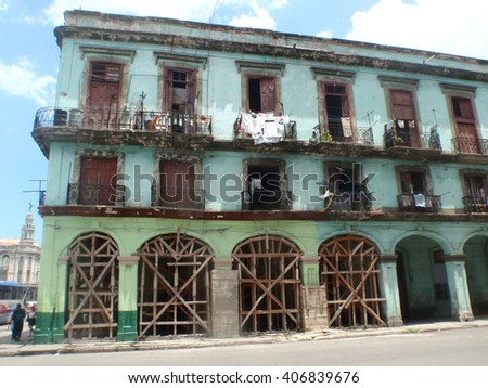 Old building in a state of disrepair on the street in Communist Cuba - stock photo