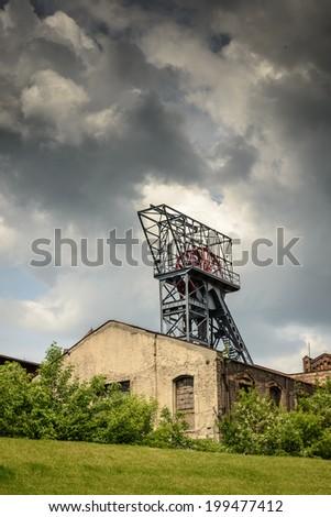 Old building,shaft coal mine and dramatic sky.Katowice,Poland - stock photo