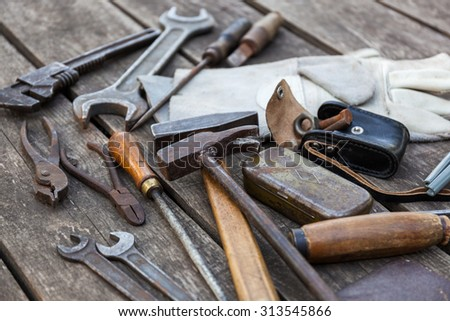 Old building tools on a wooden background, shallow depth of field - stock photo