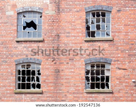 Old building with broken windows - stock photo