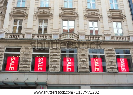 stock-photo-old-building-with-sale-signs