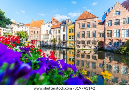 old buildings along a canal in Ghent, Belgium - stock photo