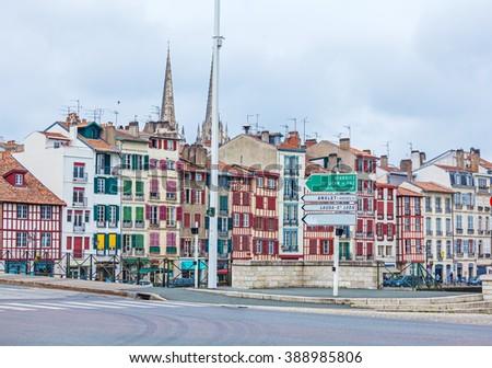 Old buildings along bank of Nive, Bayonne, France - stock photo