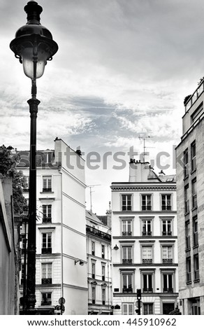Old buildings and street lamp in Paris, France