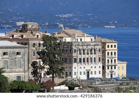 Old buildings Corfu town summer season - stock photo